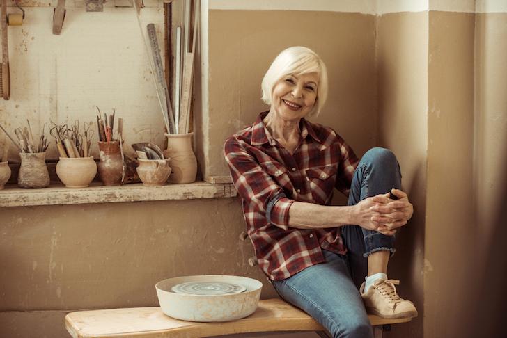 senior lady in pottery studio